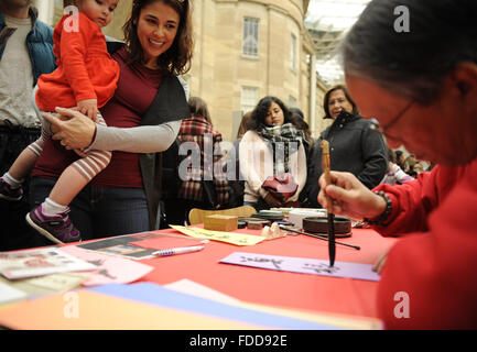 Washington, DC, USA. 30th Jan, 2016. Residents wait for their names in Chinese calligraphy as they attend a Family - Stock Photo