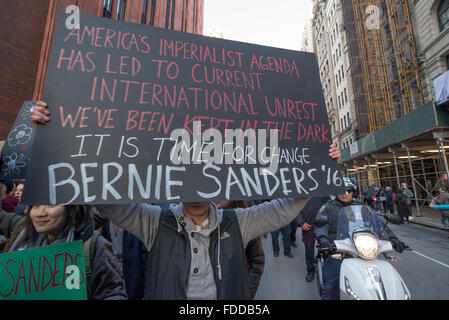 New York, USA. 30th Jan, 2016. Demonstrators hold signs and chant in support of Bernie Sanders. Supporters of Democratic - Stock Photo