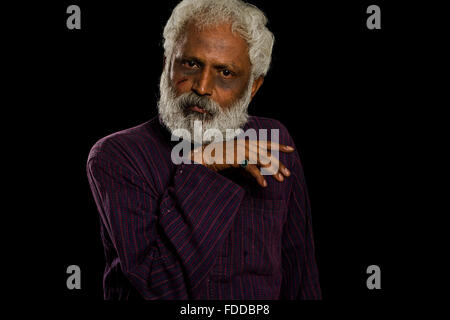 1 indian Senior Adult Man Victim Injury face - Stock Photo