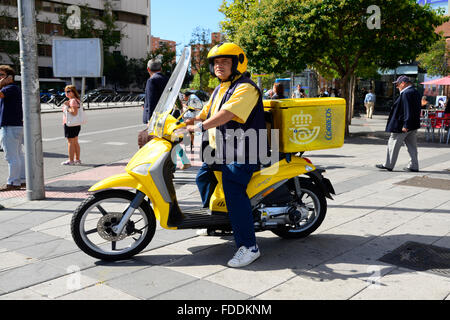 Correos Mail Carrier on Motorcycle Madrid Spain ES - Stock Photo