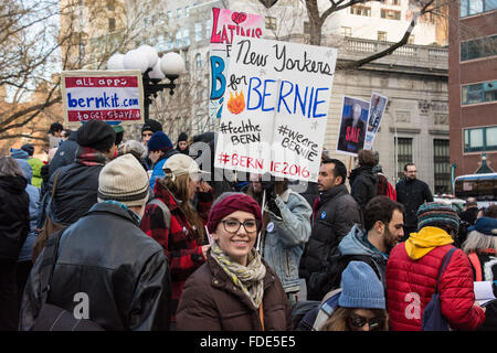 New York City, USA, 30th January 2016.  A sign signals support for Bernie Sanders by New Yorkers as one smiles broadly - Stock Photo