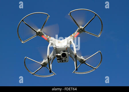 A DJI Phantom 3 Professional quadcopter (often referred to as a drone) with safety prop guards attached. - Stock Photo