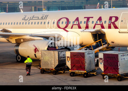 Baggage Being Loaded On To A Qatar Airways Flight, Hamad International Airport, Doha, Qatar - Stock Photo