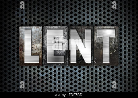 The word 'Lent' written in vintage metal letterpress type on a black industrial grid background. - Stock Photo