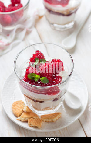 cheesecake with raspberries, mint in glass - Stock Photo