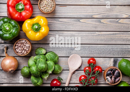 Various vegetables fruits and herbs on wooden background - Stock Photo
