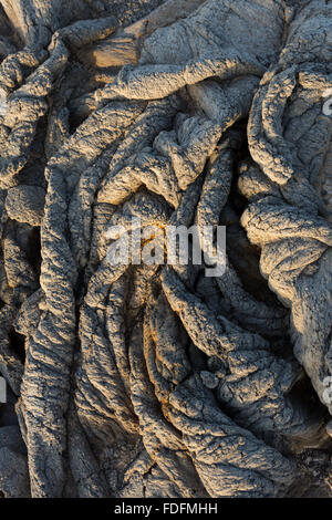 Twisted pahoehoe lava formations at Erta Ale volcano in Ethiopia, where the crust has wrinkled as the lava below - Stock Photo