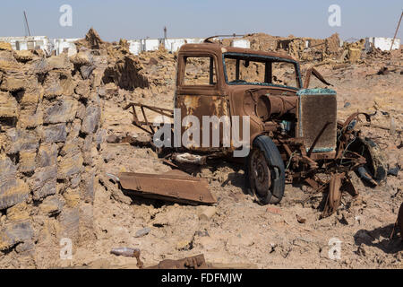 A rusting truck slowly rots away in the abandoned Italian mining camp near Dallol in Ethiopia. - Stock Photo