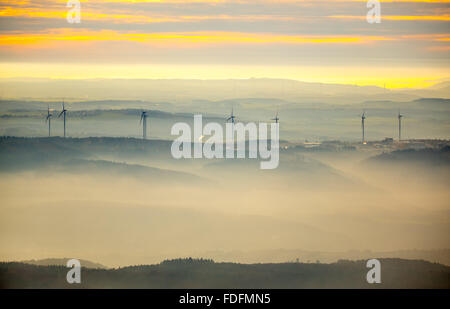 View over the mountains with wind turbines and fog, Hunsrück in Boppard, Rhine Valley, Rhineland-Palatinate, Germany - Stock Photo