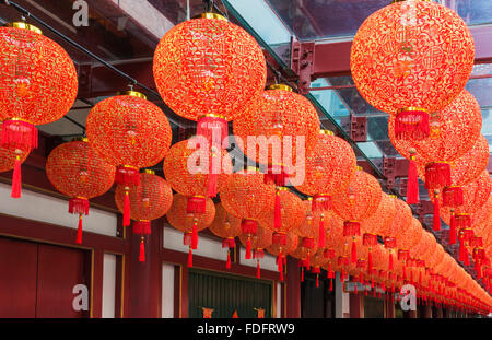 Traditional red lanterns hang from the Buddha Tooth Relic Temple and Museum during Chinese New Year in Chinatown, - Stock Photo