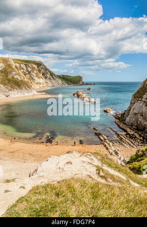 St. Oswalds Bay and Man O'War Cove at the Durdle Door Cliff Formation near Lulworth, Dorset, South England, UK - Stock Photo