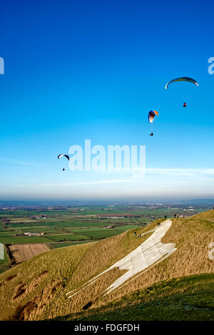 Paragliders at the Westbury White Horse, Wiltshire, United Kingdom. - Stock Photo