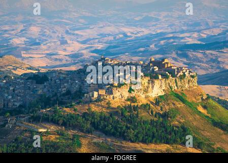 Calascibetta Sicily, aerial view of the hill-top town of Calascibetta at sunrise, central Sicily. - Stock Photo