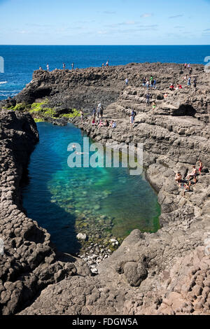 Vertical view of tourists swimming in the lagoon at Olho Azul, the Blue Eye, at Buracona - Stock Photo