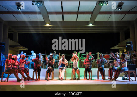 Horizontal portrait of a Cape Verdean dance troupe performing traditional folk songs in Cape Verde. - Stock Photo