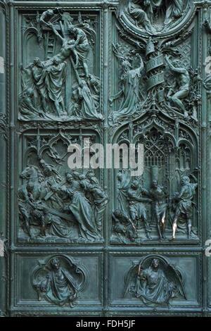 Main bronze door of the Milan Cathedral (Duomo di Milano) designed by Italian sculptor Ludovico Pogliaghi in Milan, - Stock Photo