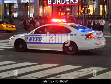 a New York Police car  on a emergency call - Stock Photo