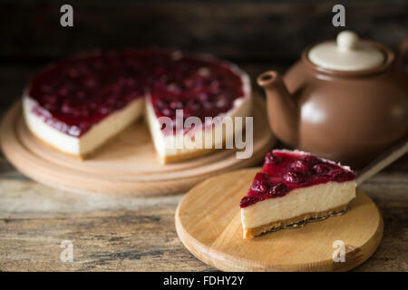 Restaurant breakfast background Piece of cheesecake with cherry Stock