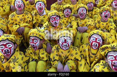 Beijing, China. 1st Feb, 2016. Children dressed up as Monkey King perform during an art fair in the Huairou District - Stock Photo