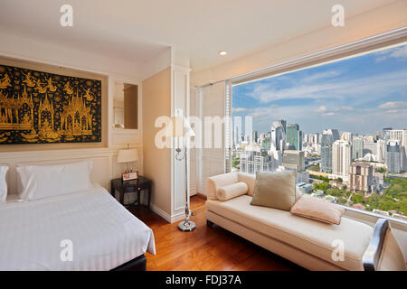 Room with city view in the Grande Centre Point Hotel Ratchadamri. Bangkok, Thailand. - Stock Photo