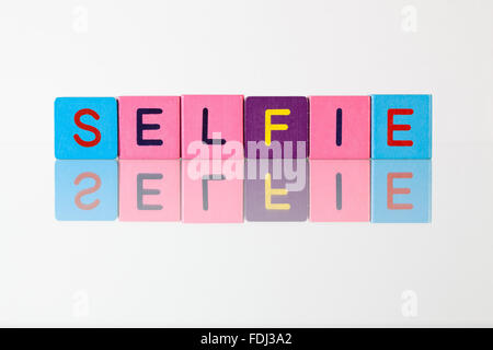 Selfie - an inscription from children's wooden blocks - Stock Photo
