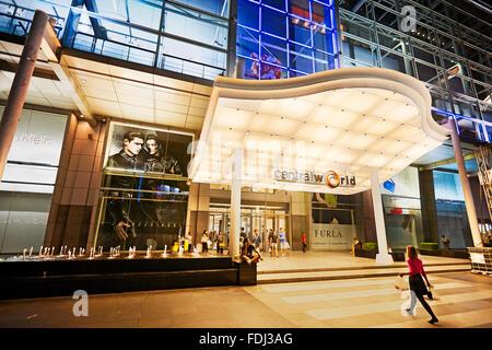 Entrance of the CentralWorld Shopping Plaza illuminated at night. Bangkok, Thailand. - Stock Photo