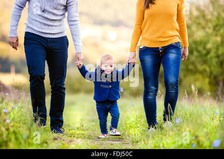 Happy family in nature - Stock Photo