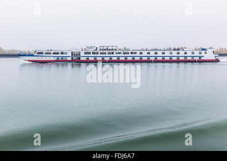 River cruise long boat on the Danube River in Slovakia. - Stock Photo