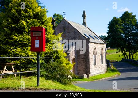 Red post Lamp box on a pole. Blencow, Cumbria, England, United Kingdom. - Stock Photo