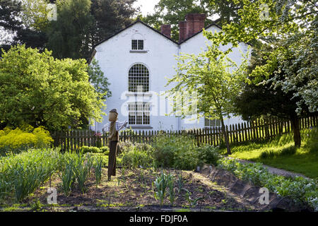 The Apprentice House and garden in May which are part of the Quarry Bank Mill and Styal Estate, Wilmslow, Cheshire. - Stock Photo