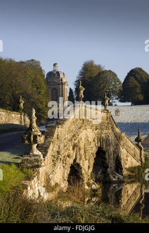 The Oxford Bridge with urns and rustic stonework on a frosty day at Stowe Landscape Gardens, Buckinghamshire.