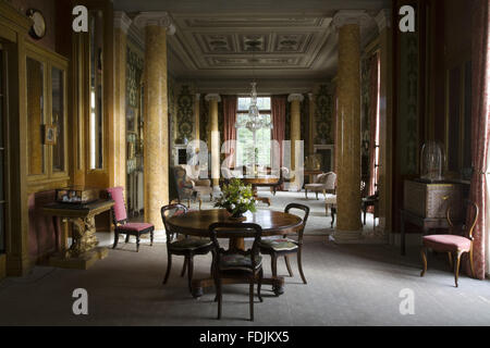 The Morning Room at Arlington Court, Devon. The room is 70 feet long with pairs of scagliola Ionic columns and can - Stock Photo