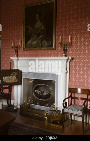 White marble chimneypiece in the Dining Room salvaged from the former house in 1820 at Arlington Court, Devon. - Stock Photo