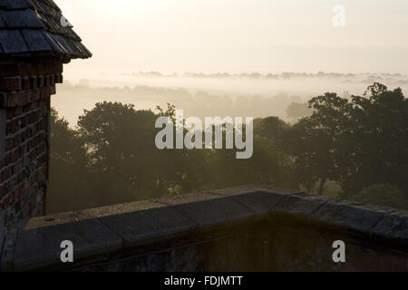 View at dawn from the Tower over the surrounding countryside at Sissinghurst Castle Garden, near Cranbrook, Kent. - Stock Photo