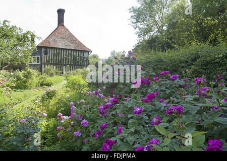 The garden and early sixteenth-century half-timbered house, Smallhythe Place, the home of actress Ellen Terry from - Stock Photo