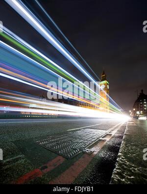 Light trails on Westminster Bridge at night, London, England, UK - Stock Photo