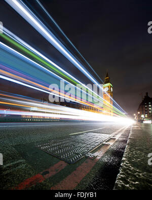 Light trails on Westminster Bridge at night, London, England, United Kingdom - Stock Photo