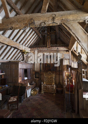 Charles Wade's Bedroom in the Priest's House at Snowshill Manor, Gloucestershire. The bedroom is in the rafters - Stock Photo
