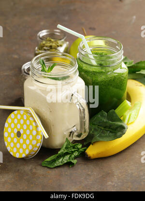 beverage with spinach, celery, pumpkin seeds and banana smoothie, detox and healthy food - Stock Photo
