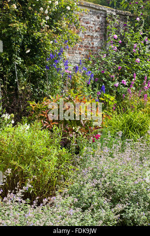 The Herbaceous Border in the garden in September at Oxburgh Hall, Norfolk. - Stock Photo
