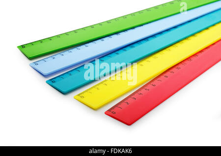 Multicolor plastic rulers on a white background - Stock Photo