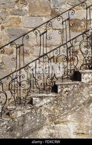 Wrought iron banisters on the steps at Avebury Manor, Wiltshire. - Stock Photo