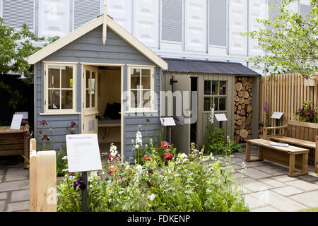 small garden design joe swift html with Stock Photo Small Gardens At Chelsea Flower Show Flowerbed Red Roses And Gypsophilia 43793339 on Pittosporum Tobira furthermore Jardines Premiados Sgd Awards 2015 in addition Pittosporum Tobira together with Stock Photo Small Gardens At H ton Court Royal Horticultural Society Show The 43706065 furthermore Greencube Rhs Show Gardens.