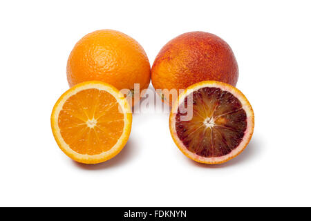 Whole and half Oranges and blood oranges on white background - Stock Photo