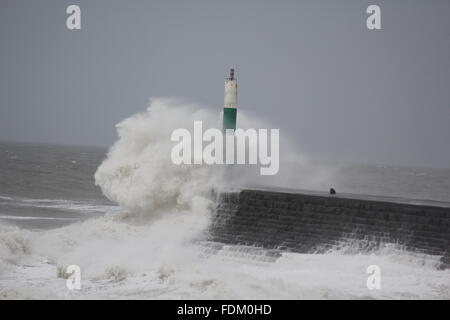 Aberystwyth Wales UK 2016, huge waves driven by gale force winds continue to batter the sea defences of the Welsh - Stock Photo