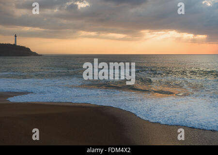 Chambre d'Amour Beach by sunset, with Biarritz Lighthouse in the background. Anglet, Aquitaine, France. - Stock Photo