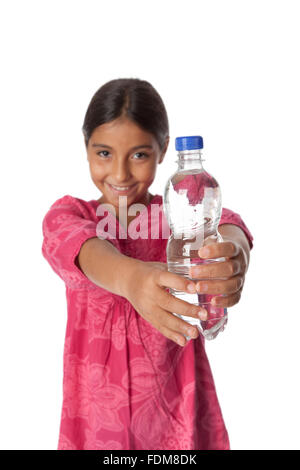 Young teenage girl showing a bottle with fresh water on white background - Stock Photo