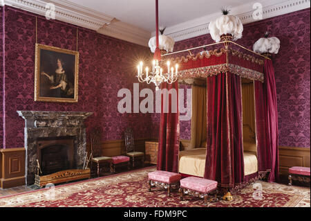 The state bed which dates from 1685 in the Queen Anne Room at Dunham Massey, Cheshire. The bed has undergone a long - Stock Photo