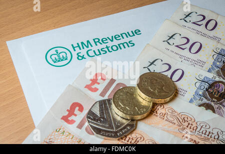 A HMRC letterhead with money - notes and coins. - Stock Photo