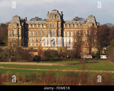View of the Bowes Museum in Barnard Castle, Teesdale, County Durham, from the far side of the River Tees. - Stock Photo